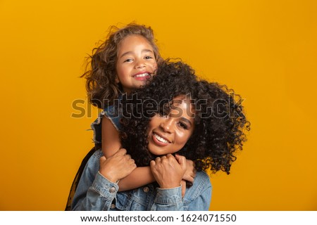 happy mother's day! Adorable sweet young afro-american mother with cute little daugh.  Royalty-Free Stock Photo #1624071550