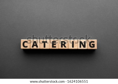 Catering - words from wooden blocks with letters, making or serving food catering concept, top view gray background #1624106551