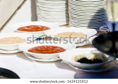 Different dishes nicely arranged by a caterer for a wonderful wedding celebration #1624121812