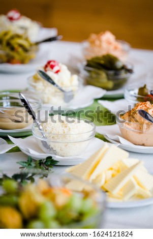 Different dishes nicely arranged by a caterer for a wonderful wedding celebration #1624121824