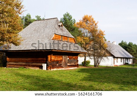 Old traditional polish wooden house in an open-air museum of Kielce (Muzeum Wsi Kieleckiej), Tokarnia, Poland, Europe. Picture taken during famous polish golden autumn.