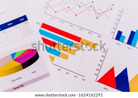 Documents with an economic report, full of colorful graphs with macro-economic data. #1624162291
