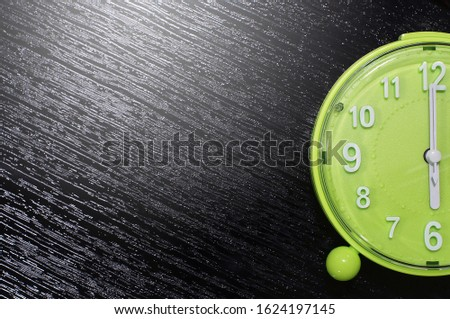 clocks placed on a black table with space for placing things in the morning. #1624197145