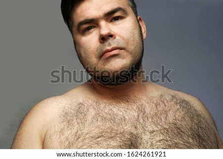Closeup portrait of a hairy man. hairy body of a man. chest, excessive hairiness, depilation. tight build. fat body. #1624261921