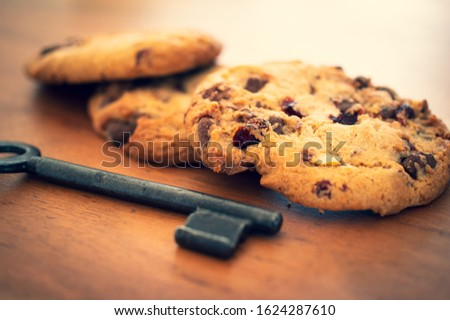 Cookies with a key to illustrate cookie banners for websites #1624287610