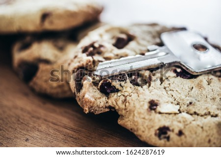 Cookies with a key to illustrate cookie banners for websites #1624287619