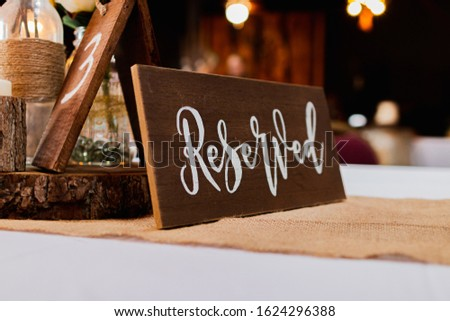 Wood Wedding Reserved Table Sign on White Table Cloth with Decorations