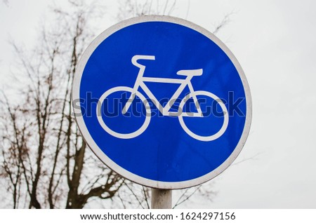 blue sign sign signing the boundary of the beginning of the cycling track #1624297156