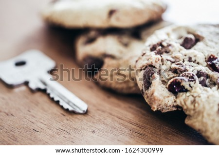 Cookies with a key to illustrate cookie banners for websites #1624300999