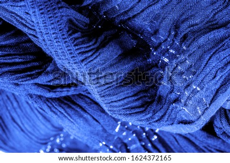 The texture of the background picture, the ornament of the decor, sapphire blue corrugated fabric, fabric with parallel or diagonal folds with serrated folds; products from such a fabric. #1624372165