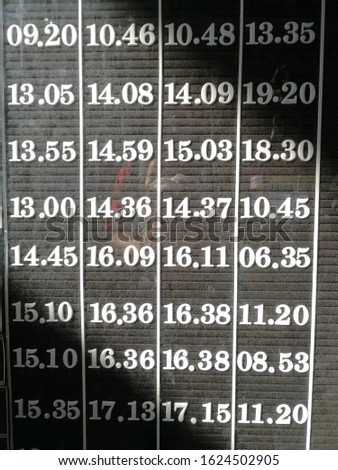Time schedule of mass transit, time letter, time board, white letter on black board. Transportation schedule of train, plane, bus, boat.