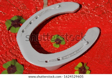 horseshoe and lucky clover on a red background #1624529605
