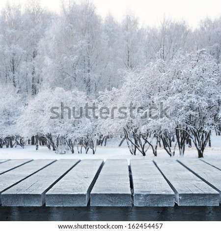 Table for picnic and winter background Royalty-Free Stock Photo #162454457