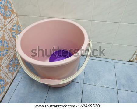Clean bucket on clean toilet #1624695301