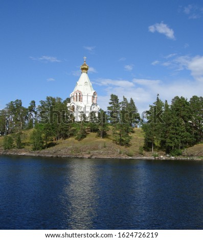 Lake Ladoga and the shores of Valaam island in Karelia. Russia. There is a small Church on the rocky shore #1624726219