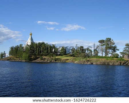 Lake Ladoga and the shores of Valaam island in Karelia. Russia. There is a small Church on the rocky shore #1624726222