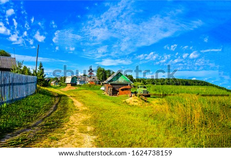 Summer rural village road view. Russian village in summer. Rural village scene in Russia #1624738159