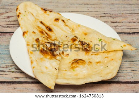 Naan is a leavened, oven-baked flatbread found in the cuisines mainly of Iran, India, Western Asia, South Asia, Central Asia, Myanmar. #1624750813