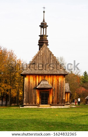 Old traditional polish wooden church in an open-air museum of Kielce (Muzeum Wsi Kieleckiej), Tokarnia, Poland, Europe. Picture taken during famous polish golden autumn.
