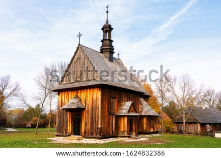 Old traditional polish wooden church in an open-air museum of Kielce (Muzeum Wsi Kieleckiej), Tokarnia, Poland, Europe. Picture taken during famous polish golden autumn.