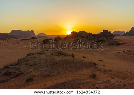 Vintage photos from archive. Jordan. Sunset in Wadi Rum desert. Martian landscapes in lifeless desert. Red rocks and red sand.  #1624834372