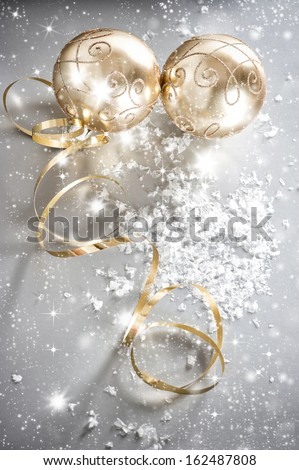 shiny christmas balls with golden streamer. falling snow and blinking lights effect. selective focus #162487808
