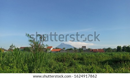 Landscape of active volcano in Yogyakarta, Indonesia from countryside. The countryside located in Kalasan regency. This mountain called Merapi.  #1624917862