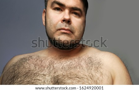 Closeup portrait of a hairy man. hairy body of a man. chest, excessive hairiness, depilation. tight build. fat body. #1624920001