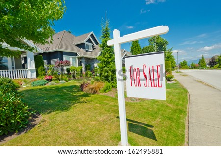 House, sign for sale for big custom made luxury house in the suburbs of Vancouver, Canada.