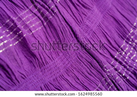 Texture background pattern, decor ornament, dark lilac corrugated fabric of blue cent, Fabric with parallel or diagonal folds of dentate folds; products from such a fabric. #1624985560