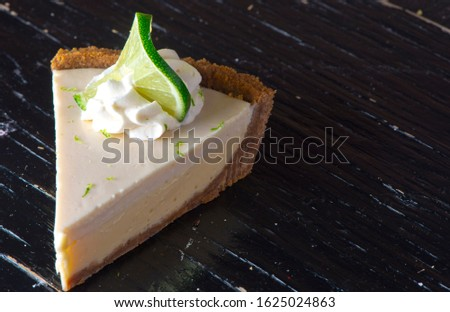 Key Lime Pie. Classic traditional American dessert favorite. Key lime pie, raw mixture made with the juice from Key West lime juice, condensed milk sugar and eggs poured into graham cracker crust.  #1625024863