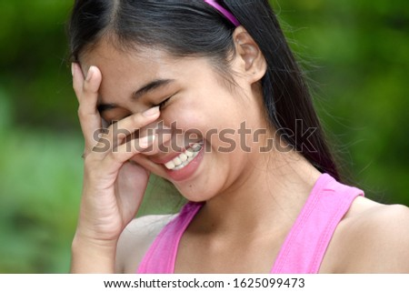A Female Youngster And Laughter #1625099473