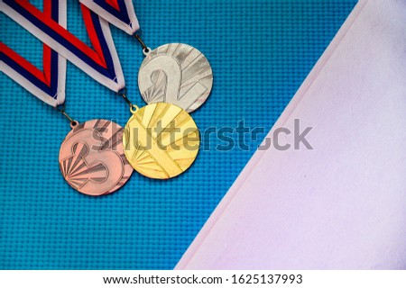 Gold silver and bronze medal on blue background, white edit space. Original photo for summer olympic game 2020 Tokyo