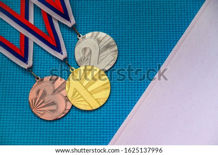 Medal ceremony concept photo. Blue background, white edit space. Original photo for summer olympic game 2020 Tokyo
