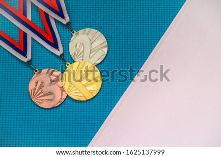 Gold silver and bronze medal on blue background. White edit space. Original photo for summer olympic game 2020 Tokyo
