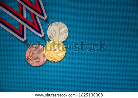 Medal set on blue background. Gold silver and bronze, blue edit space. Original photo for summer olympic game 2020 Tokyo
