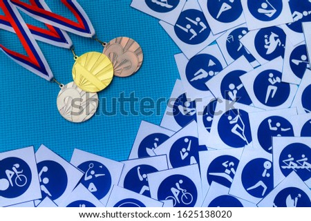 Sport template. Gold silver and bronze medal, Sport icons, blue background. Original photo for summer olympic game 2020 Tokyo