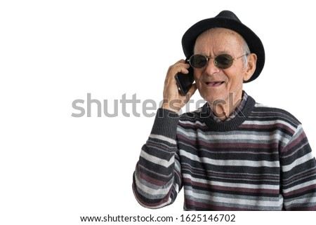 Heated discussion. Old toothless man in sunglasses and black hat having a conversation on the phone and gesticulating emotionally while posing isolated on a white background, studio photo