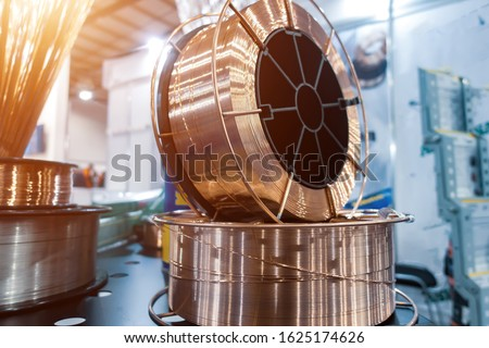 Copper-plated welding wire for welding low carbon and low alloy steels Royalty-Free Stock Photo #1625174626