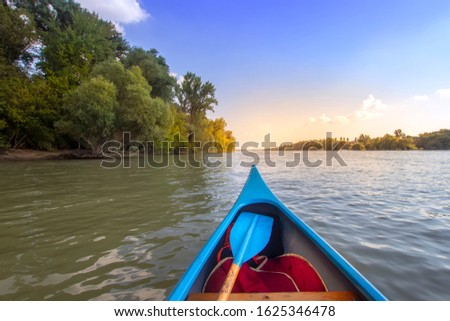 Kayaking on the Danube river at Budapest with view of the beautiful nature. Hungarian sport destination near Római-part. Nature outdoor background. Family adventure with kayak  in nature.