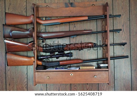 Gun Rack, top to bottom: 22 rifle, 308 bolt action rifle, 308 semi-automatic rifle, 12 Gauge shotgun #1625408719