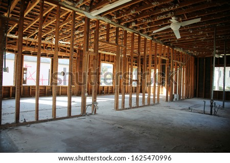 Home or Building Demolition. Remodeling of a Home or Office Building. An empty building with the walls and appliances removed. Bare Wood Frame inside an old building during a remodeling job.  #1625470996