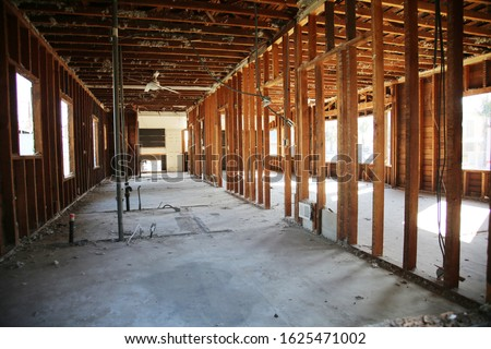 Home or Building Demolition. Remodeling of a Home or Office Building. An empty building with the walls and appliances removed. Bare Wood Frame inside an old building during a remodeling job.  #1625471002
