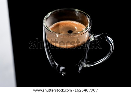 black coffee in a glass transparent cup on a black background #1625489989