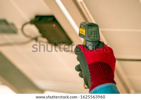Engineering used an infrared thermometer to measure the temperature of junction box in solar panel to confirming systems working normal and check for heat to other mechanical devices. #1625563960