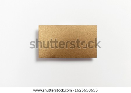 Gold blank matt textured business card flying and isolated on white background, us standard size 3.5 x 2 inches, real professional studio photo.