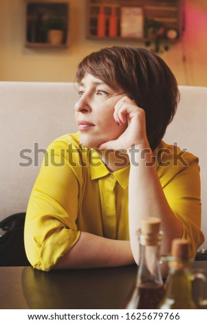 Portrait of mature woman in cafe #1625679766