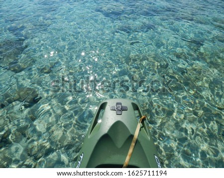 Kayaking in Croatia on an active holiday, pictures with the kayak and the seascape of the blue, transparent water and pebbly, rocky coastline