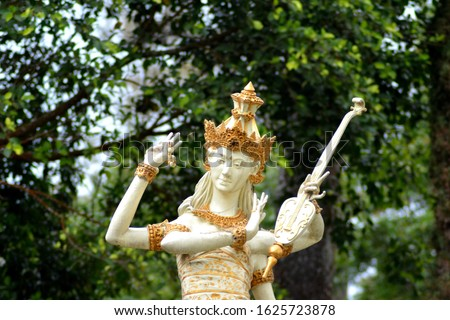 Statue of Dewi Saraswati or Sarasvati,  Hindu Goddess of knowledge,  music,  art, wisdom and learning.  #1625723878