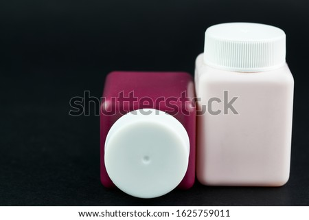 Groupe of cosmetic bottles at black background Royalty-Free Stock Photo #1625759011